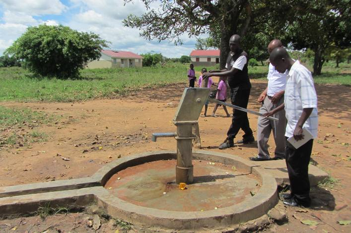 Field officer's doing a technical visit to check constructed boreholes by CIDI in Napak District